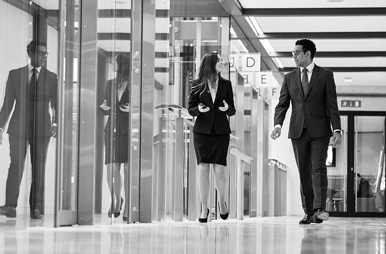 Man and woman walking in corridor